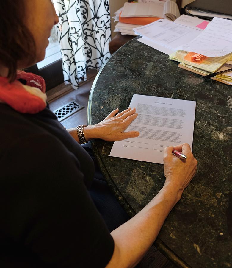 Signing a fiscal sponsorship memorandum of understanding.